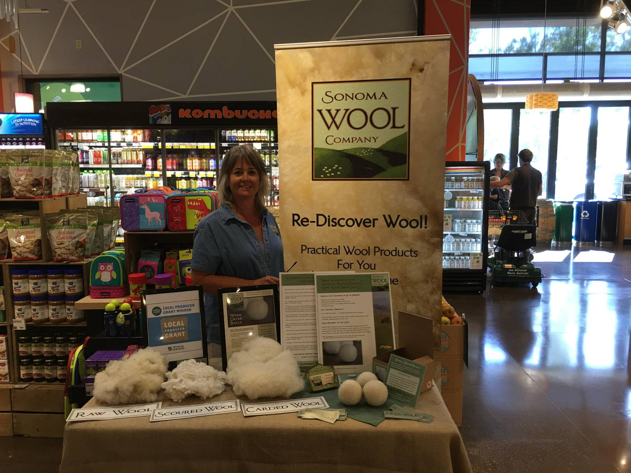 Sonoma Wool Company owner Amy stands at her booth in a store in Sonoma in 2015