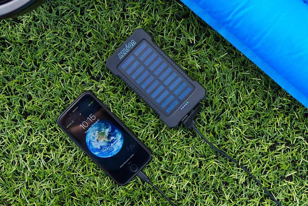 Voltzy, the solar powerbank, charging an iPhone.