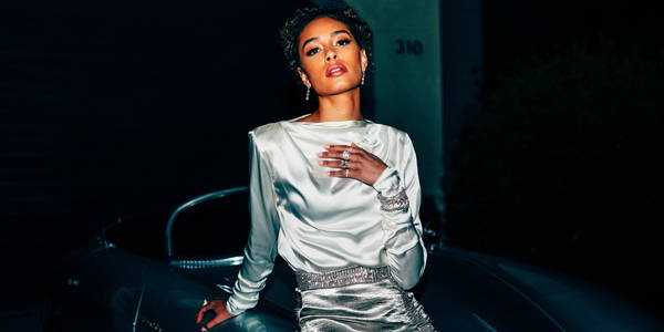 Model leaning on a car wearing Ring Concierge jewelry