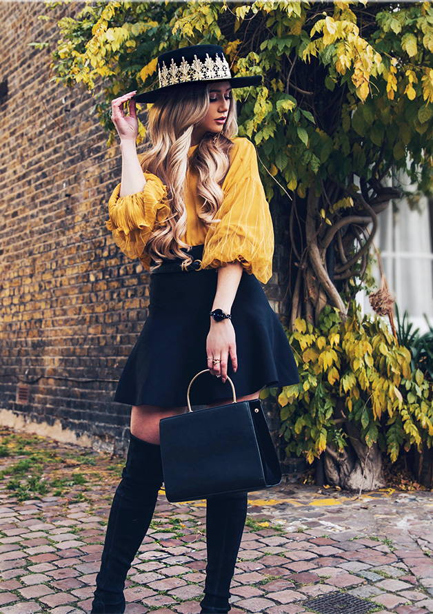 fashionable girl in black and yellow outfit