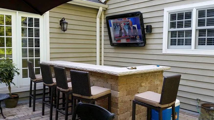 The TV Shield Outdoor Enclosure/Cabinet in a patio bar