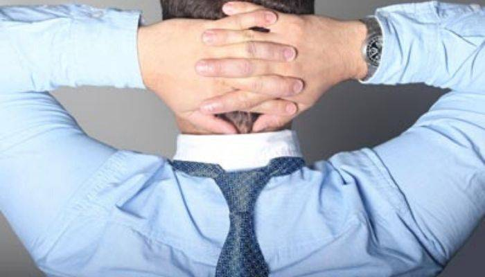Man wearing necktie down back