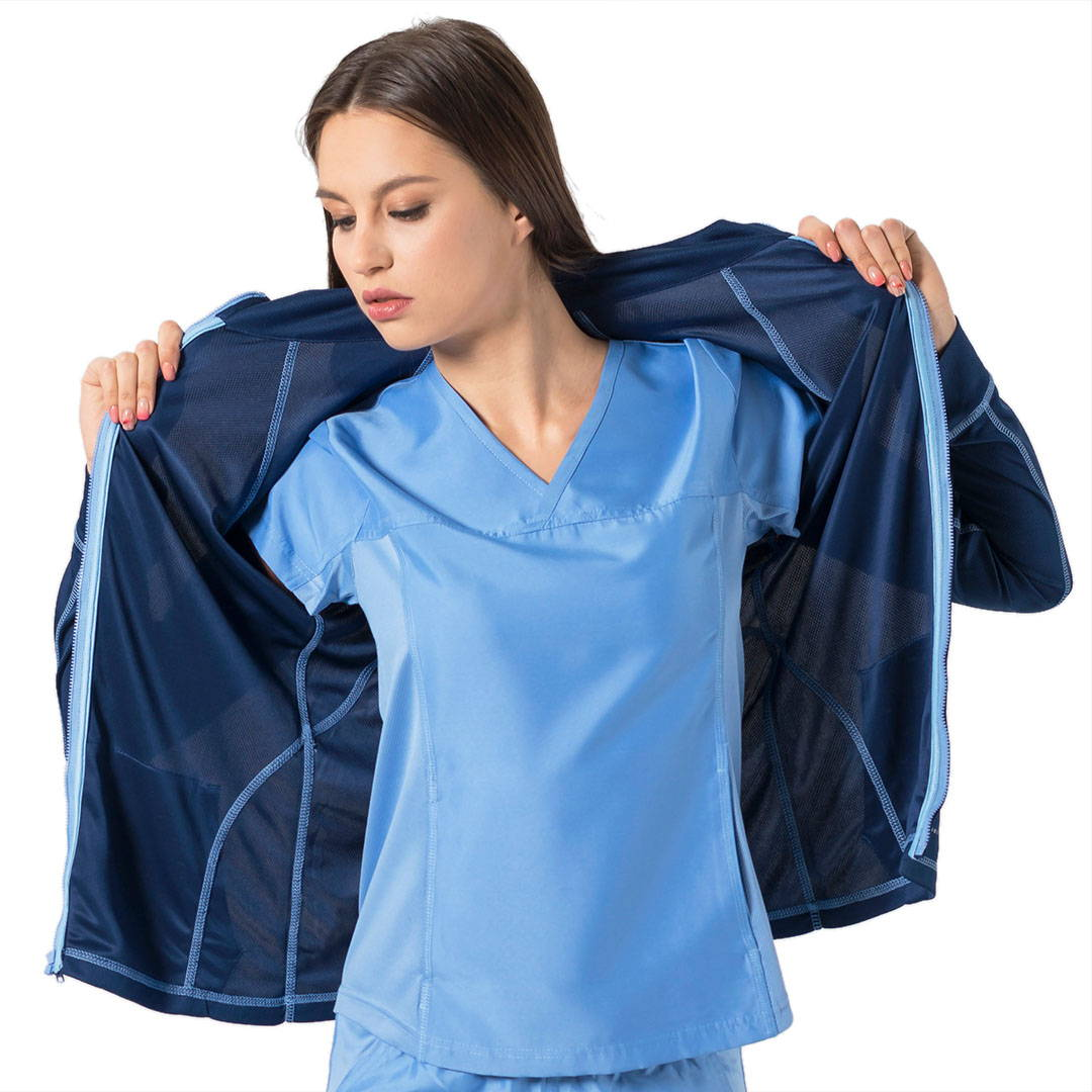 Women In Ceil Blue Scrub Top And Scrub Jacket