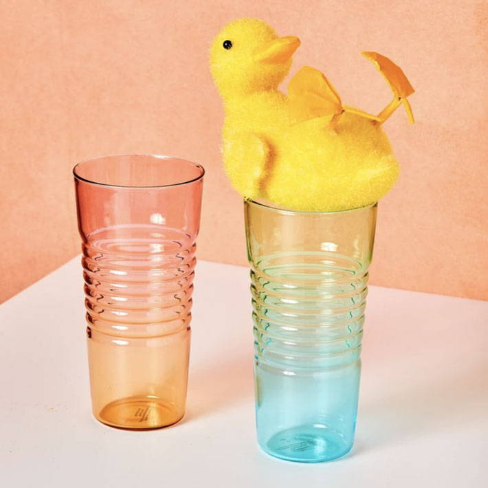 Ombre orange and blue shot glasses with a duck on top.