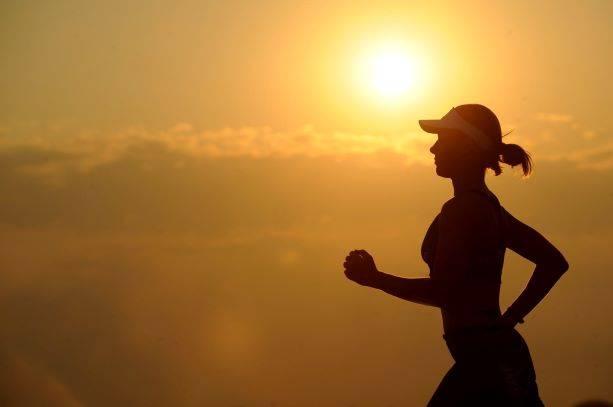 Womn With White Sunvisor Running