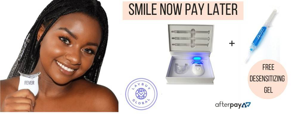 girl smiles holding led light for whitening teeth