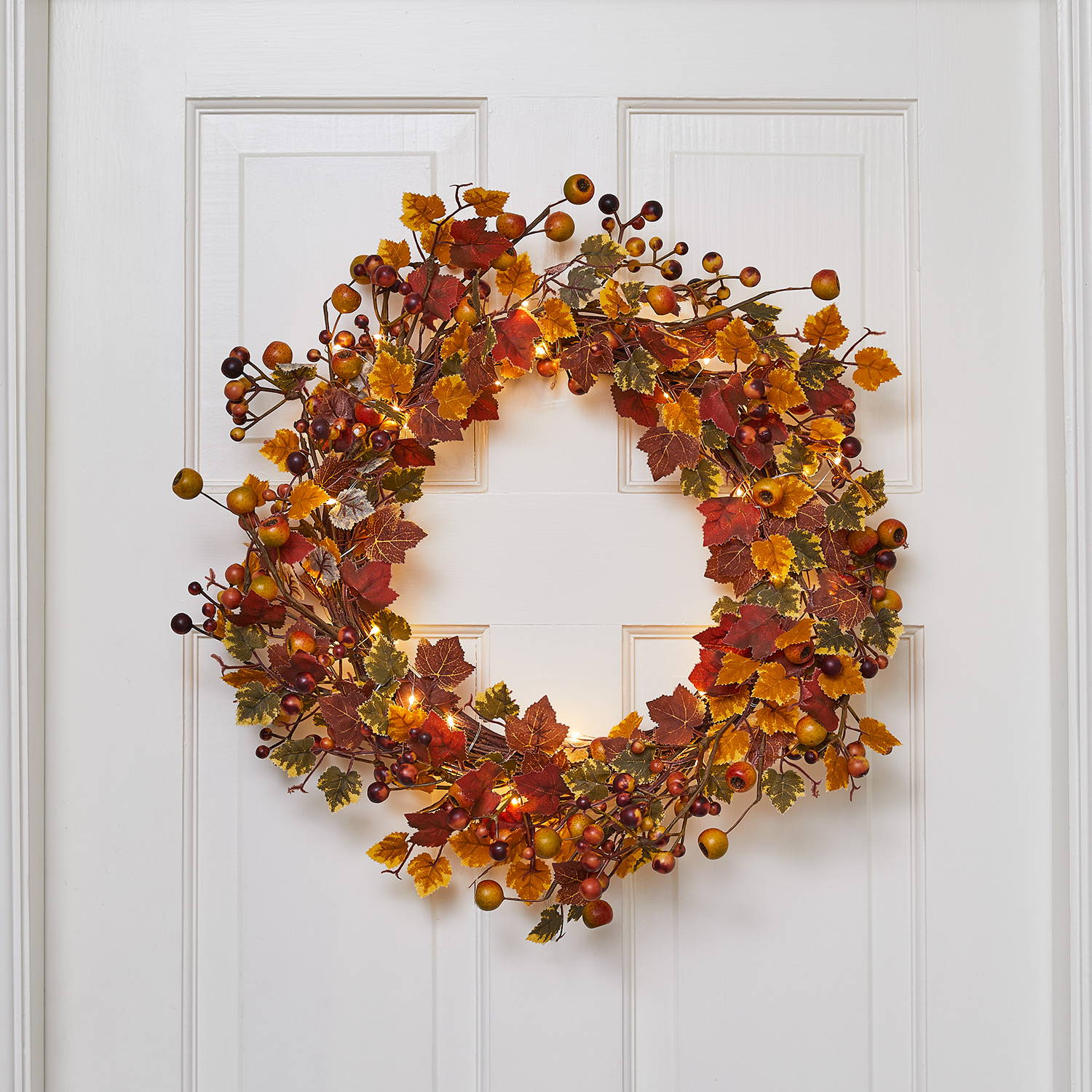 Internal door featuring a harvest autumn wreath entwined in micro lights