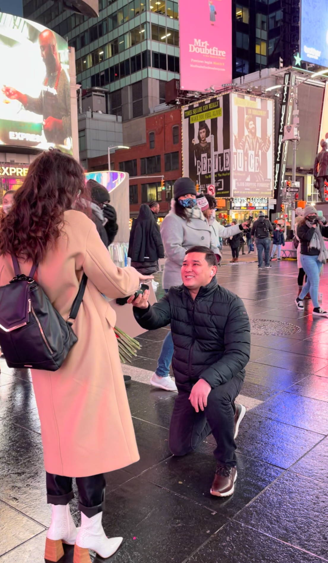 Daniyar Proposing to Elmira in Times Square With An Engagement Ring from Henne Jewelers