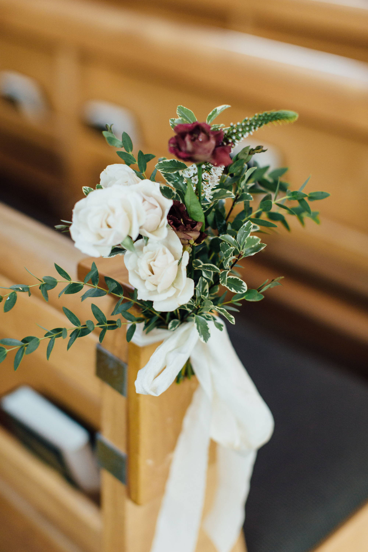 Church pews flowers in Mississauga church wedding