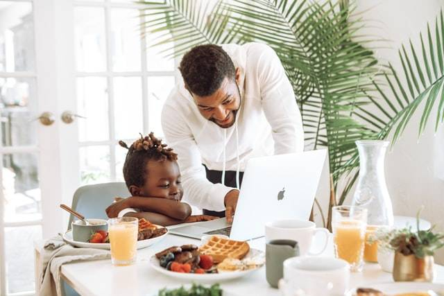 Father Showing Child A Laptop