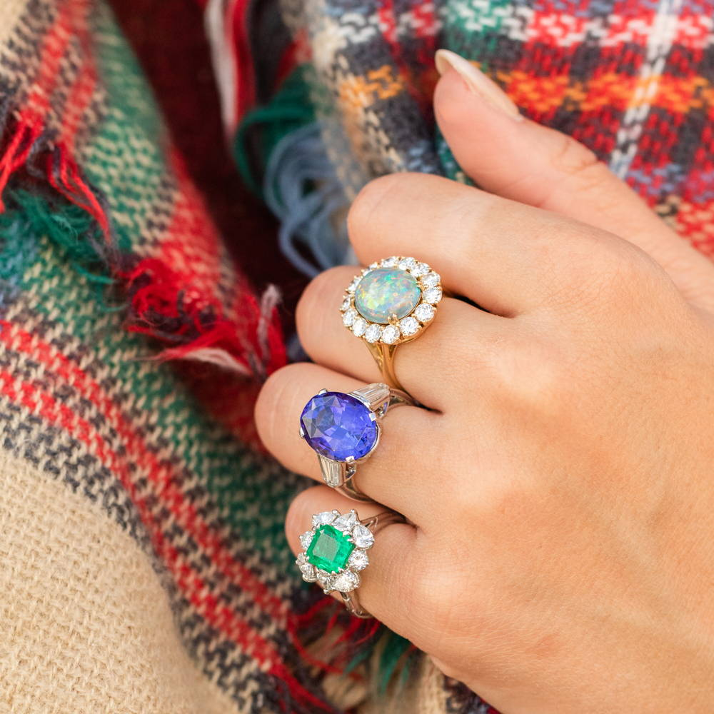 Opal, sapphire and emerald engagement rings