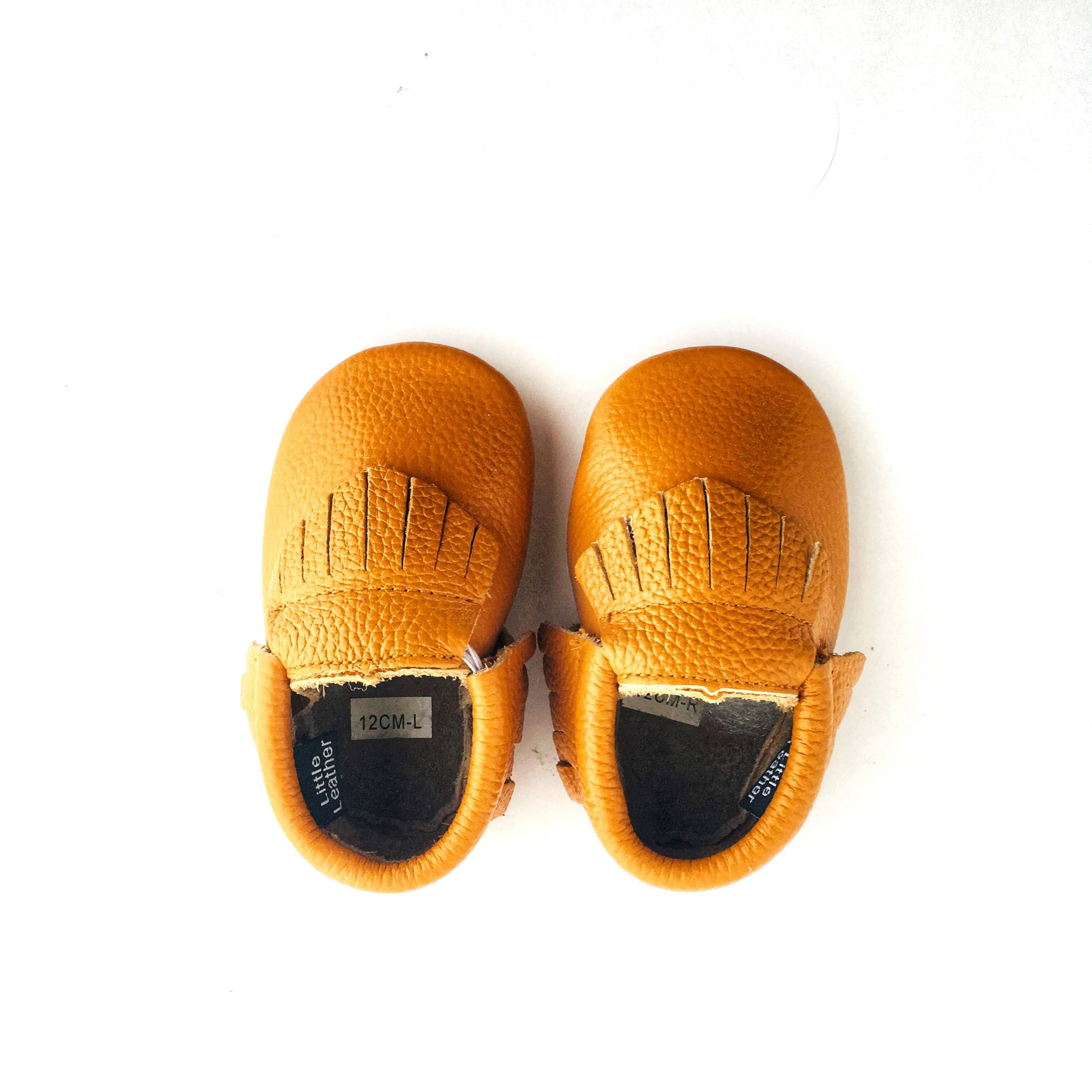 Caramel colour soft sole shoes with fringe view from above