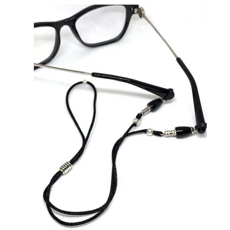 Balancing Eyeglass Retainer prevents nose dents and slipping glasses. Keeps glasses off nose.