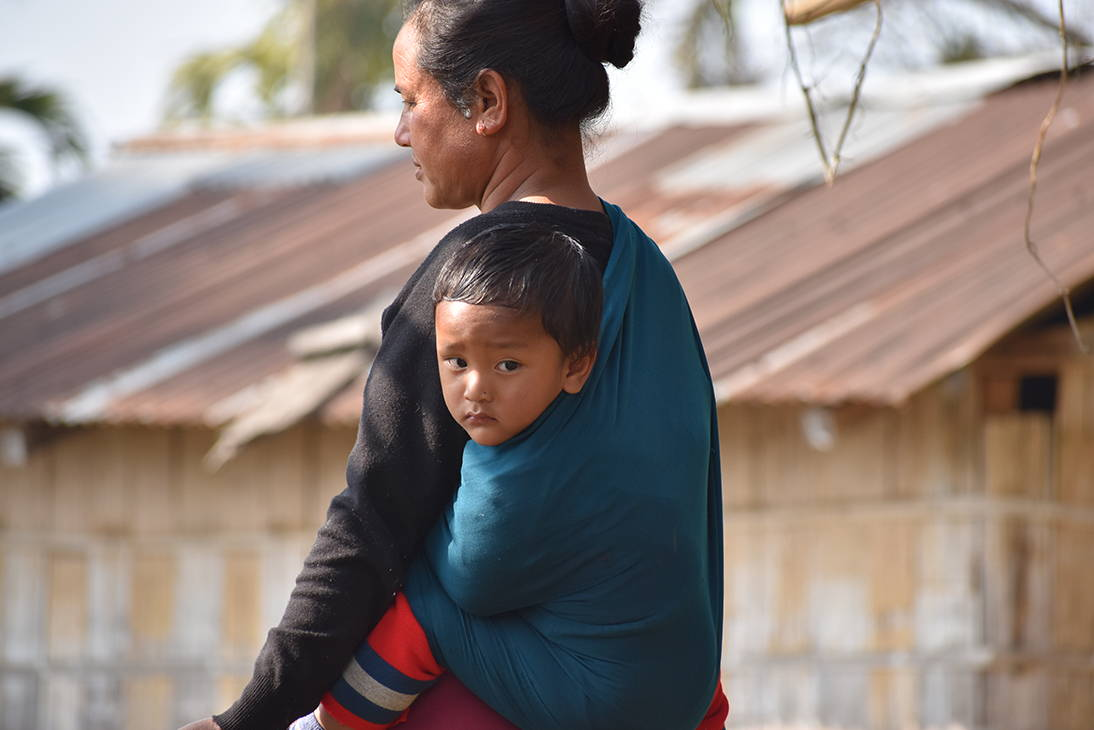 Khasi mother with traditional baby sling