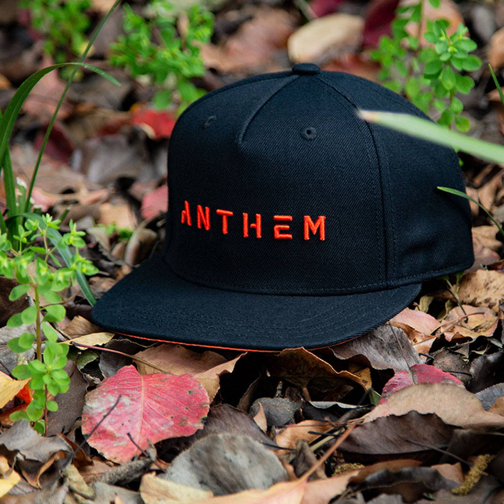 Photo of black and orange Anthem hat.