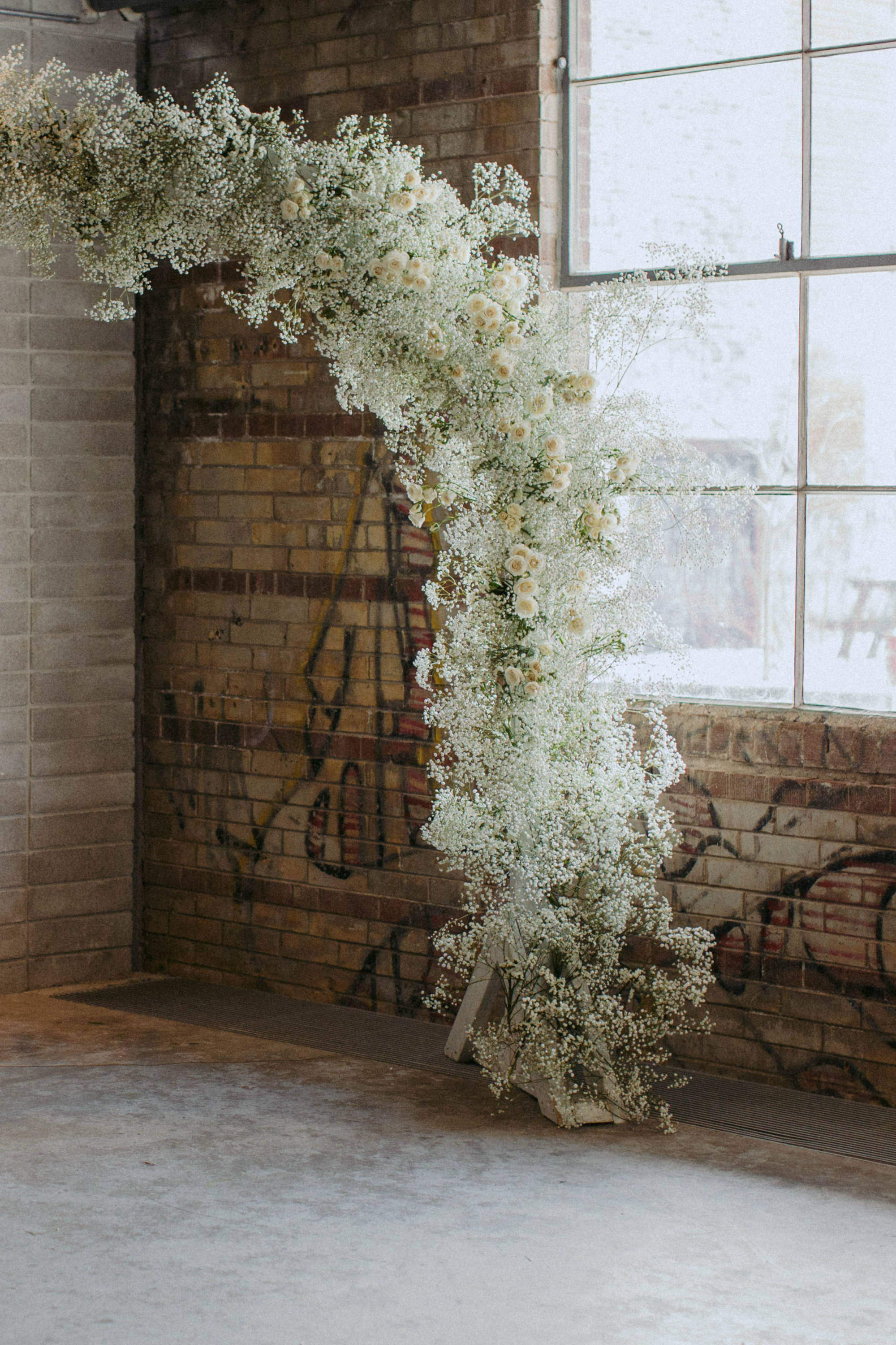 Floral arch with baby's breath at Evergreen Brickworks Toronto