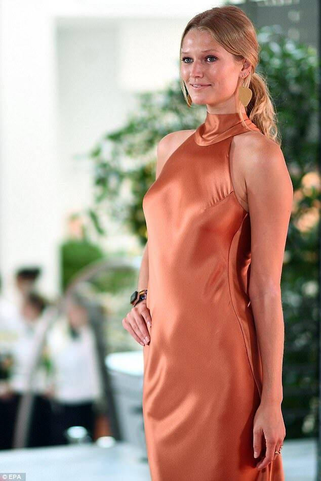 Toni Garrn at German Media Awards wearing Galvan London High Neck Satin Dress