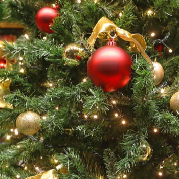 An artificial Christmas tree decorated with ornaments and Christmas balls