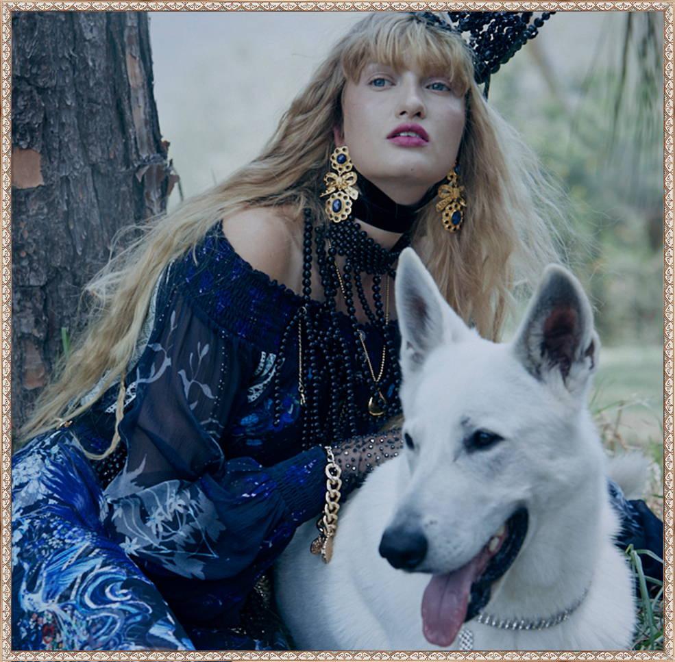 Woman in Camilla Dress Patting dog