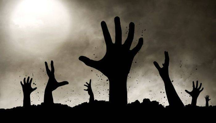 Zombie hands coming out of dirt