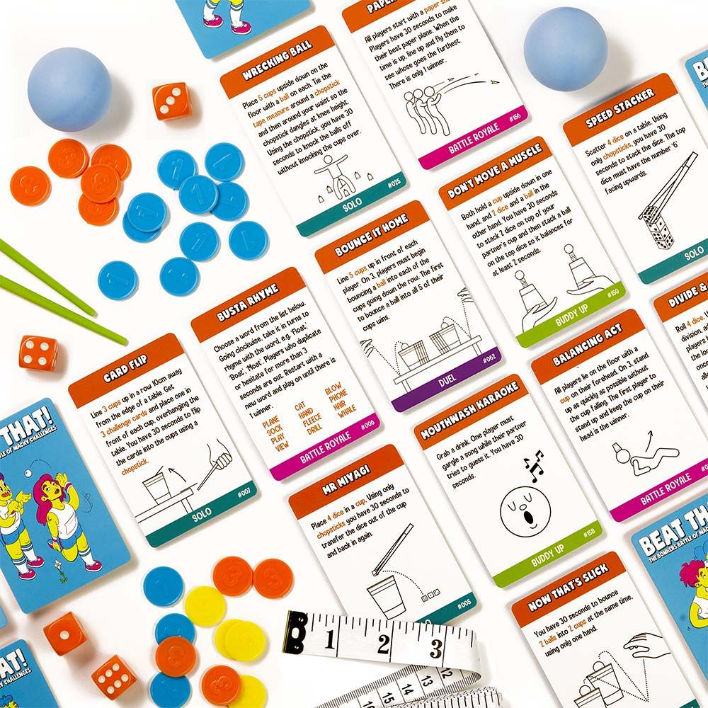 Close up of Beat That! game challenge cards