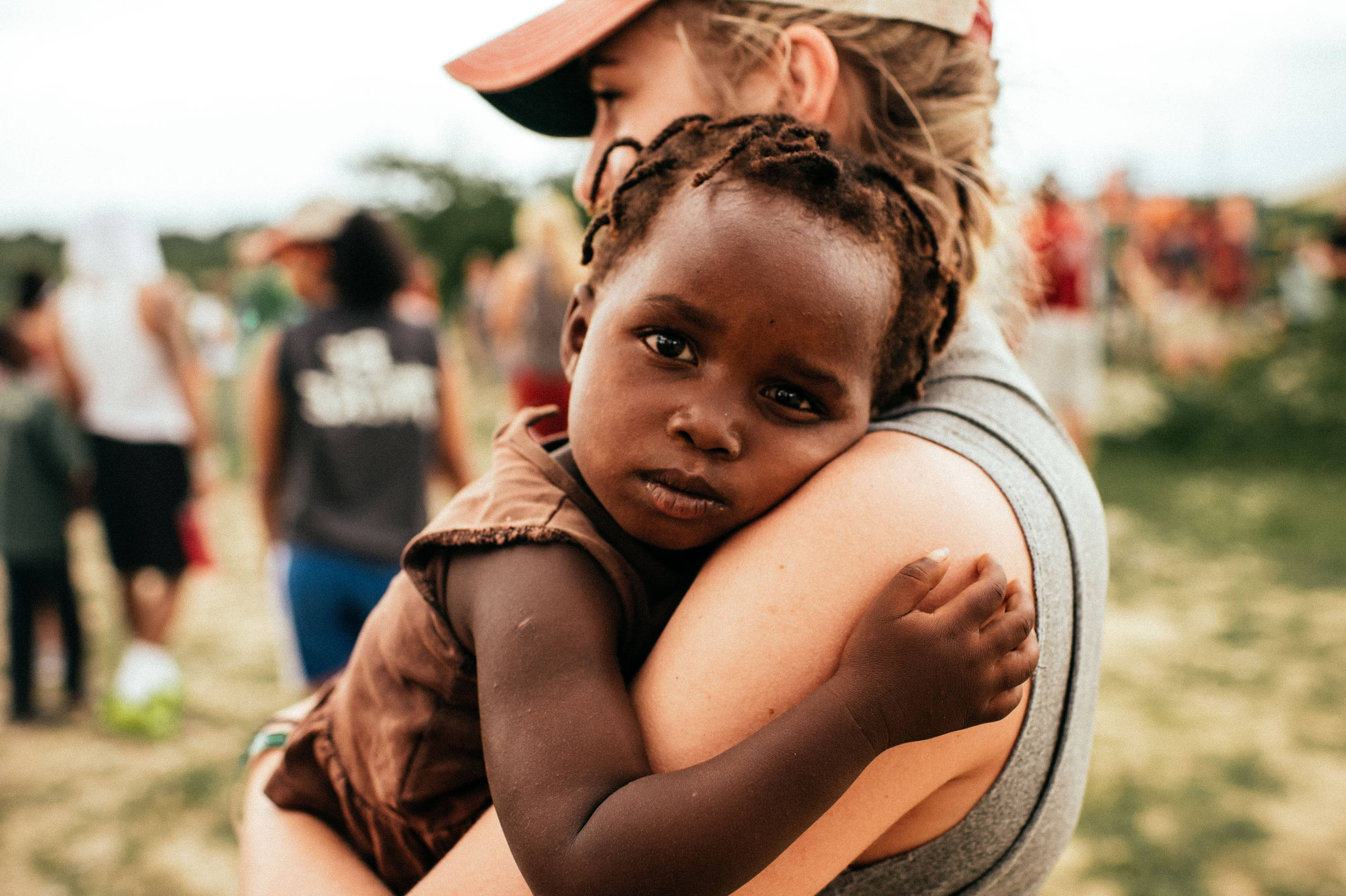 A girl holding a child in need in Africa