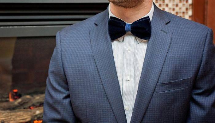 Man wearing blue velvet tie with suit jacket
