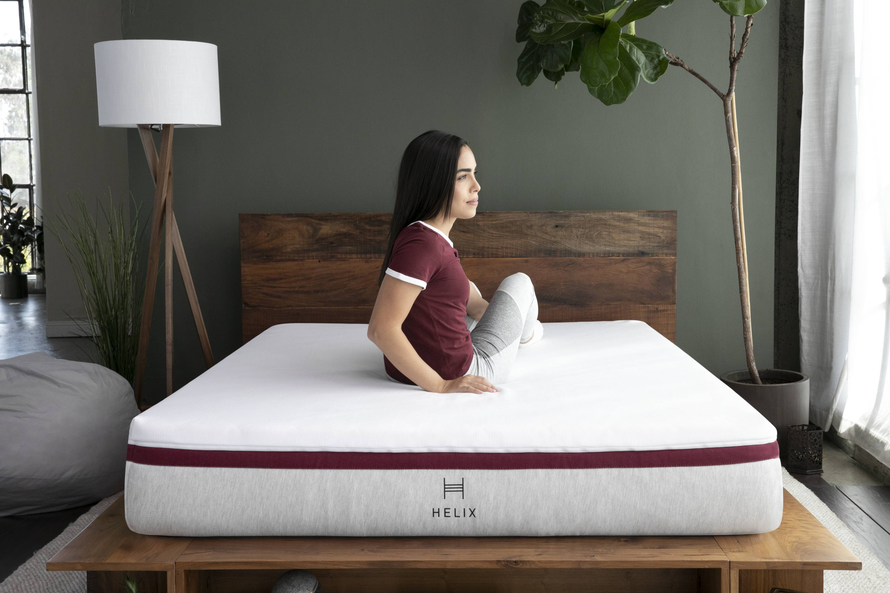 A woman stretching and relaxing on her new Helix Dusk Mattress