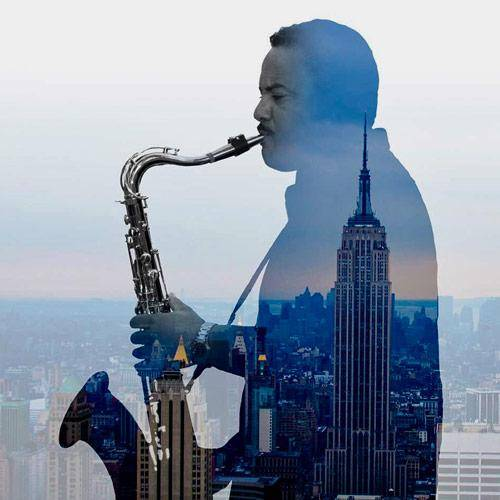 Darryl F. Walker playing saxophone with a city scape