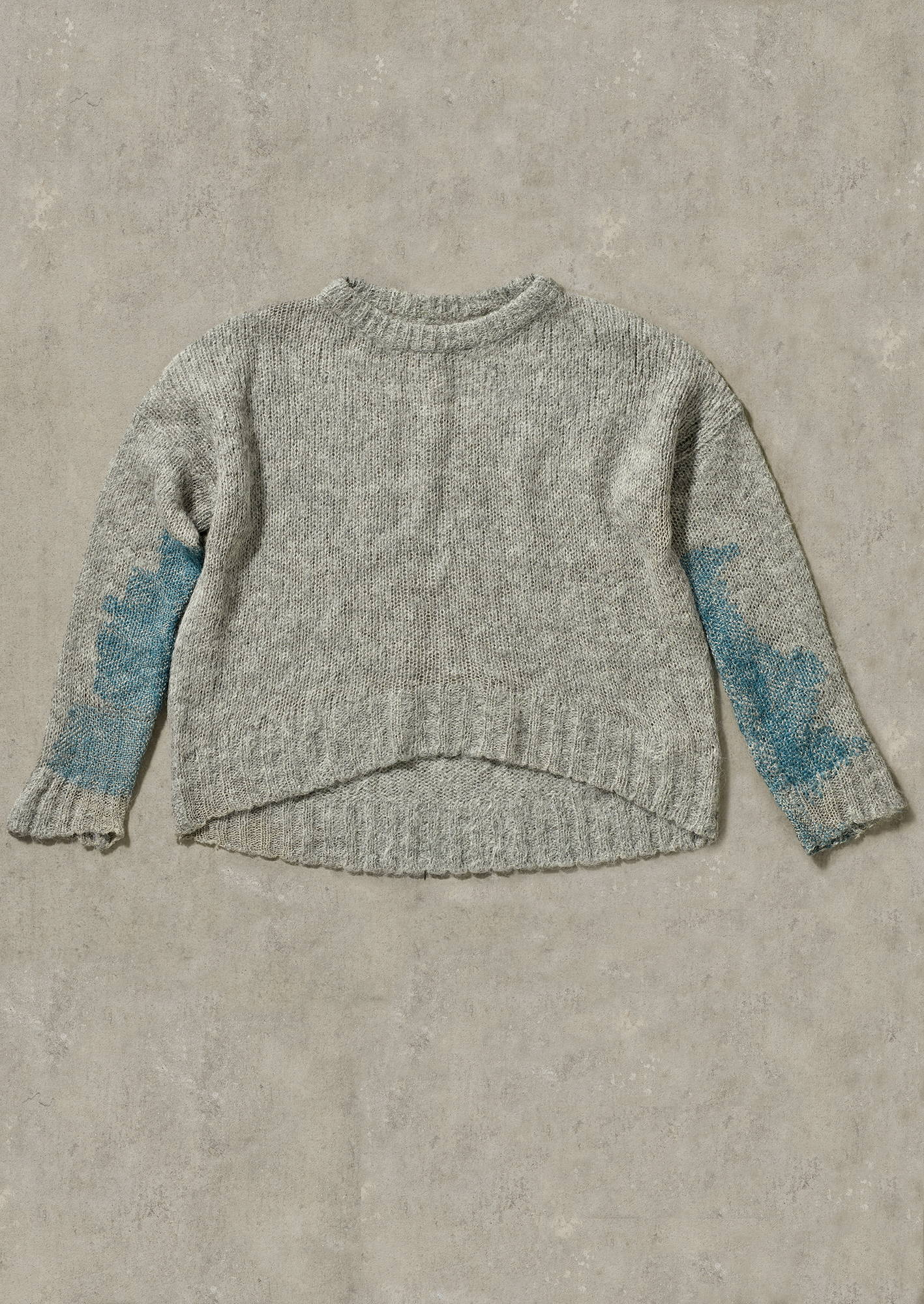 Grey sweater from TOAST with mended sleeves.