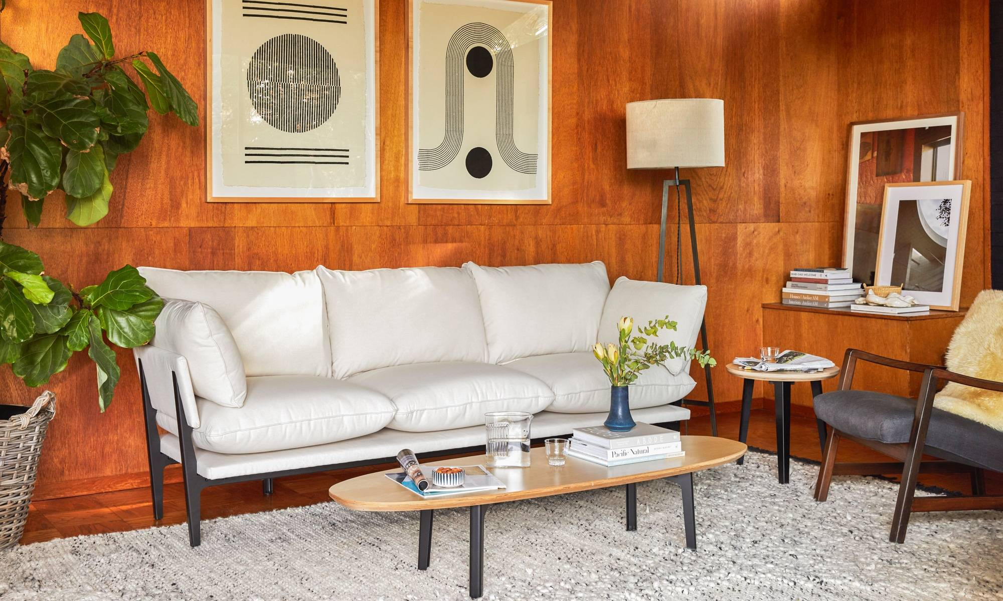White Floyd sofa in Oat in front of a beautiful walnut paneled wall and blockshop print art.