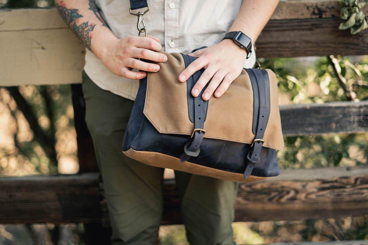 navy leather messenger bag with shoulder leather strap