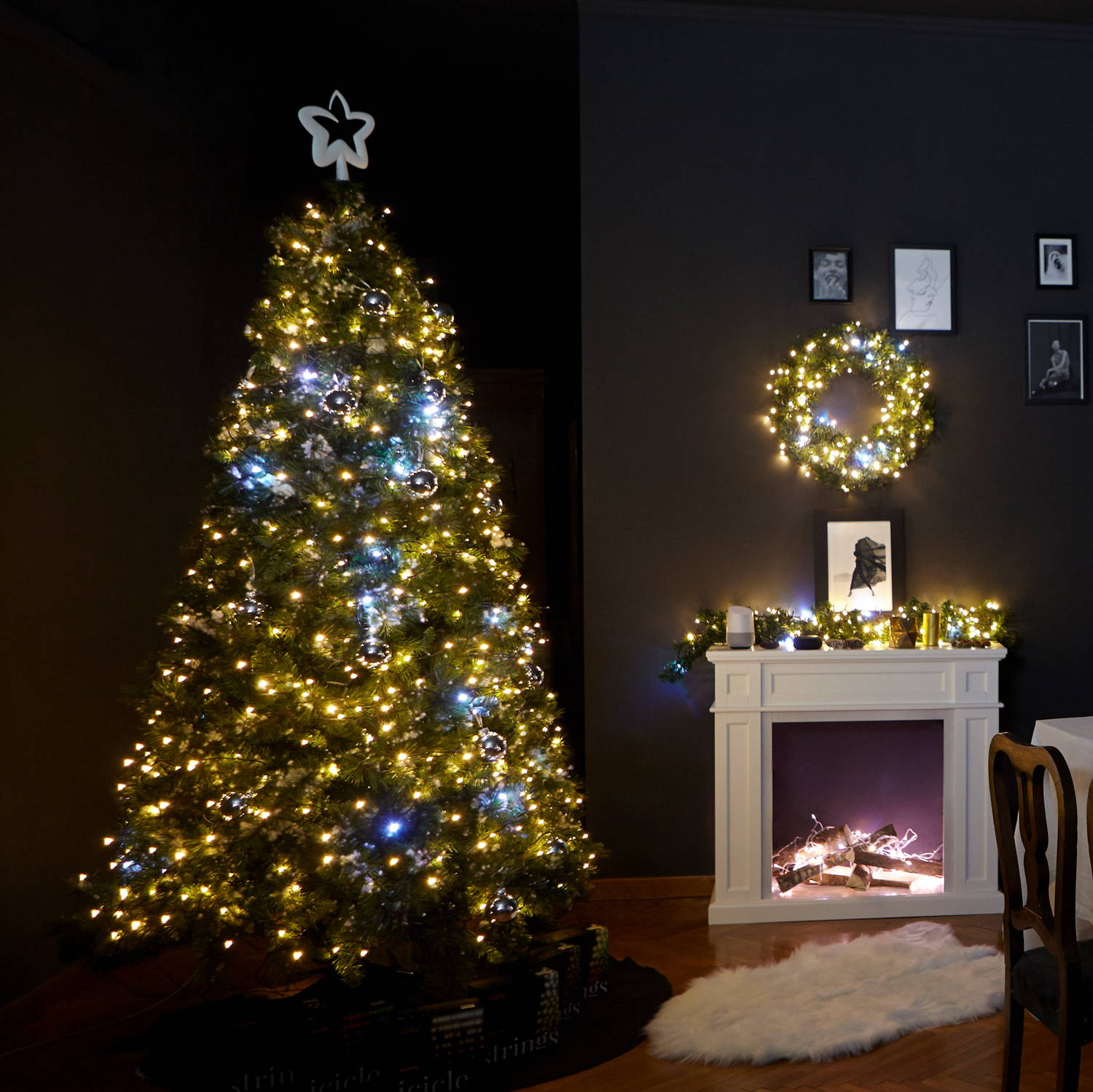 Gold edition Twinkly string lighting adorning Christmas tree, wreath and garland in living room