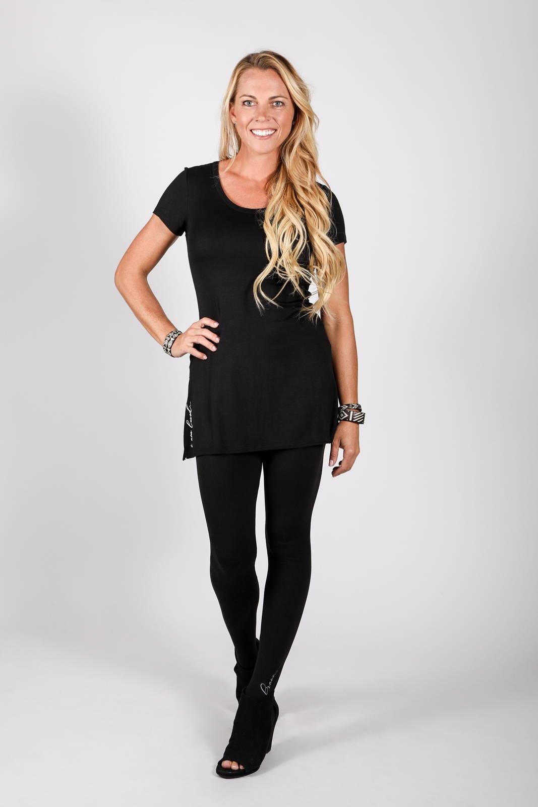 Model wearing the Dawl Tunic in black and Lumo Legging in black