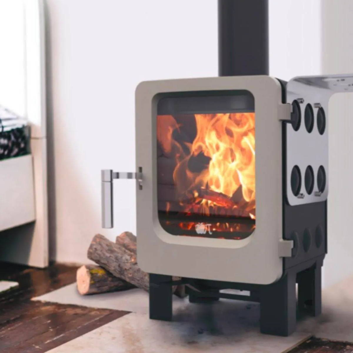An Ekol stove burning in a fireplace