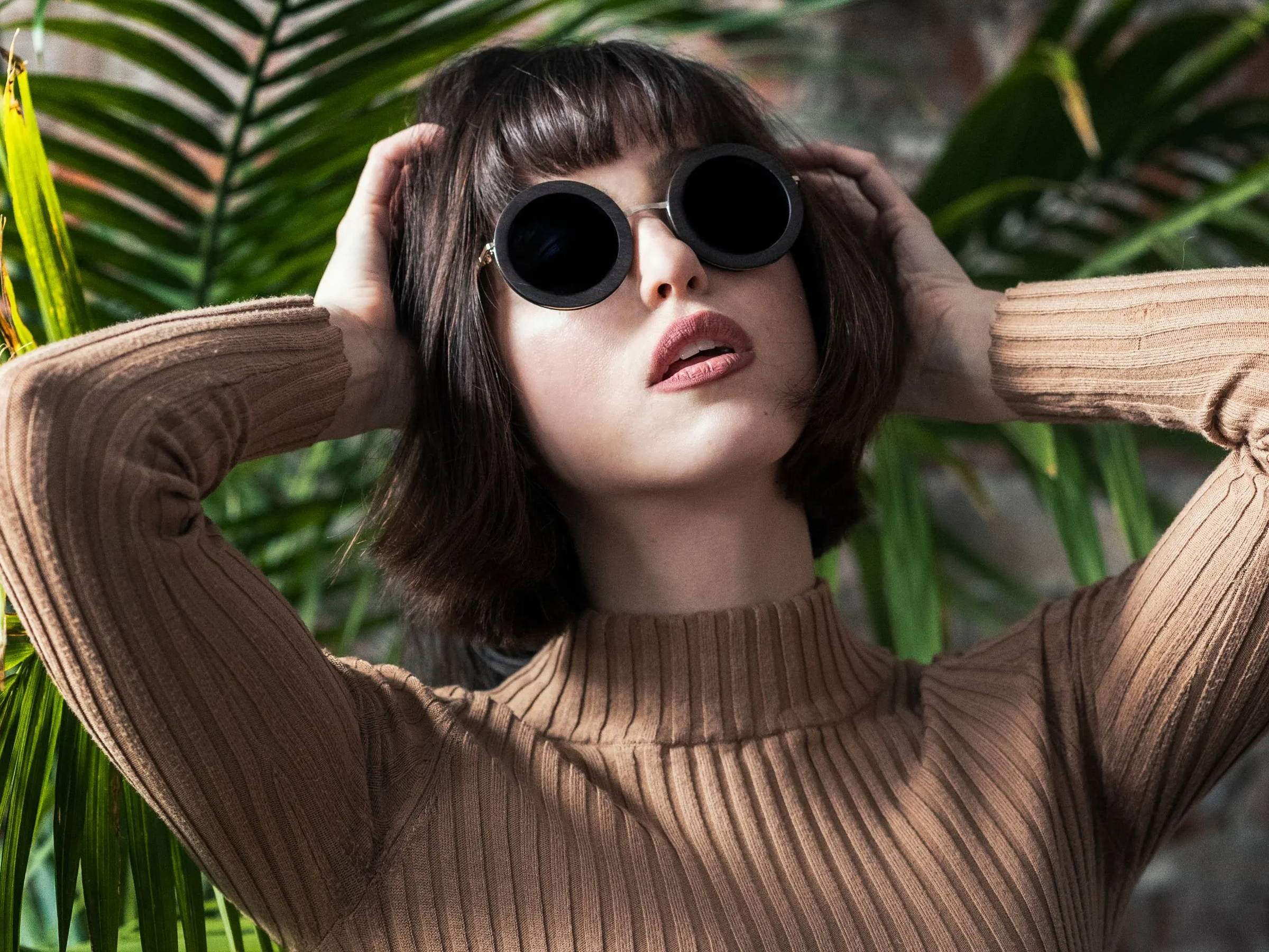 Woman wearing Kraywoods Birch, Oversized Round Sunglasses made from Ebony wood with polarized lenses