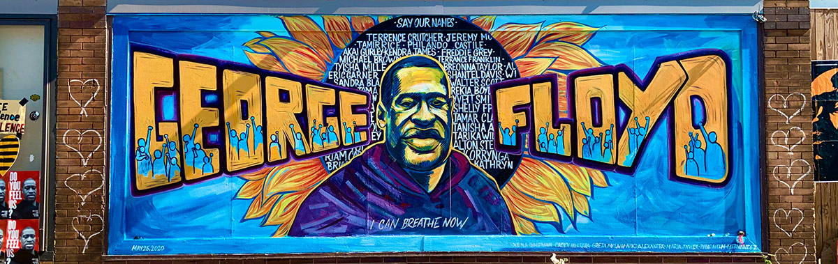 Mural of George Floyd with flowers at memorial where he was murdered