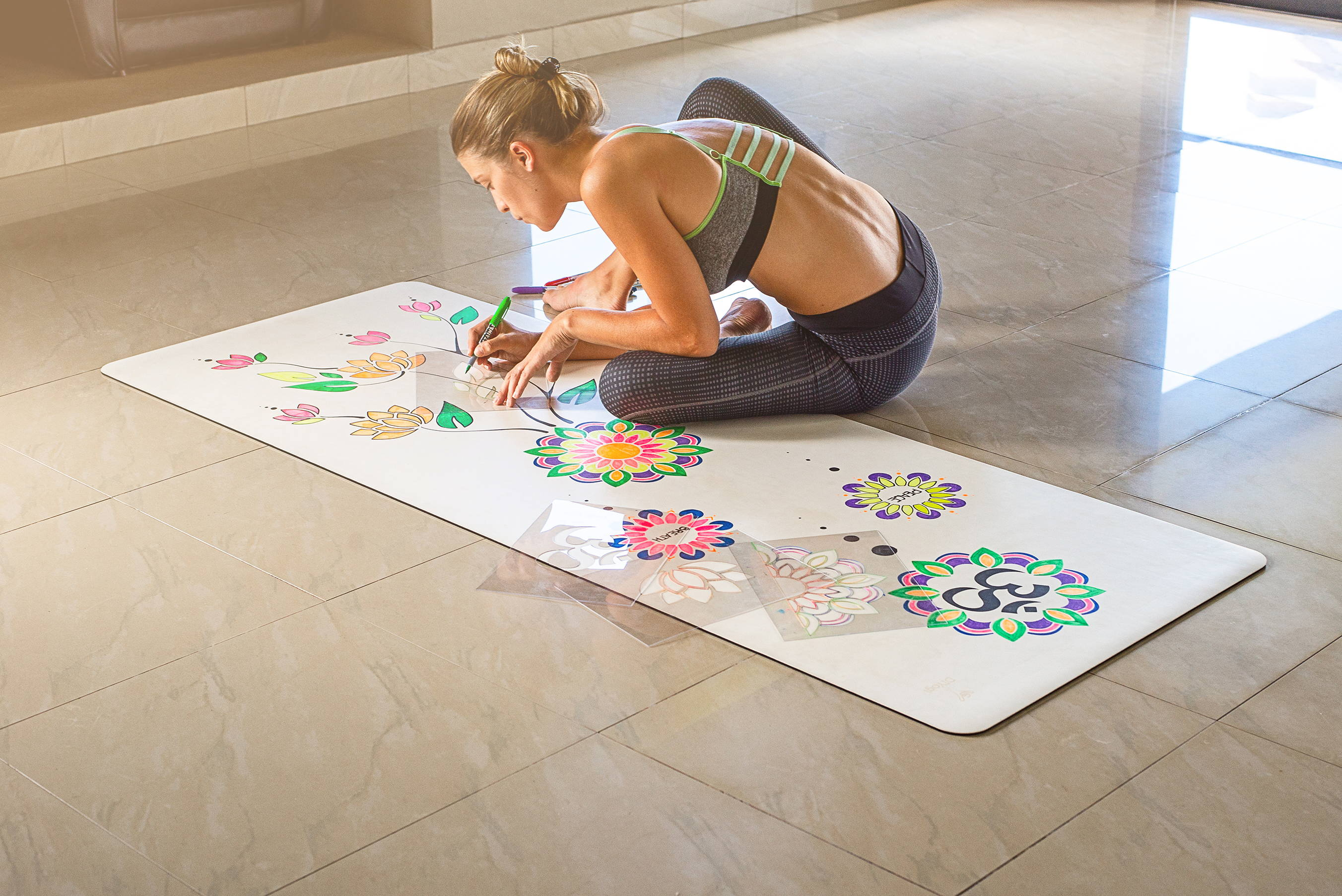 DIYogi white customisable yoga mat being personalised using drawing stencils