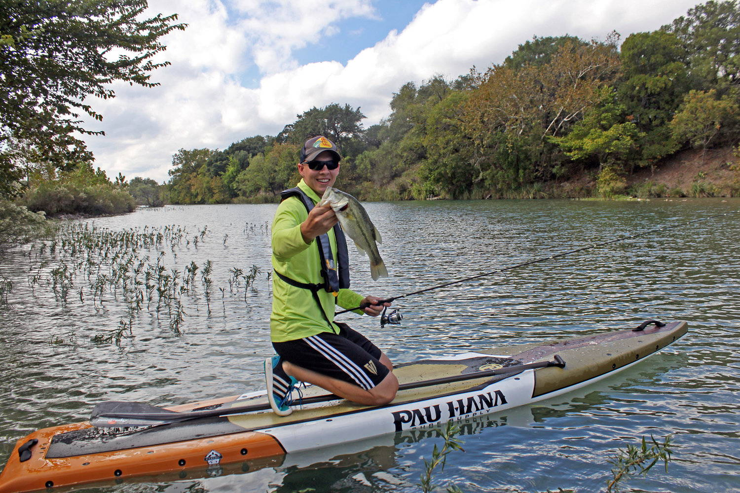 a man catching a fish on the pau hana endurance SUP
