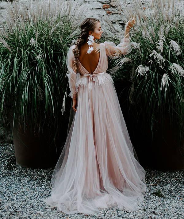 Affordable wedding dresses at She Wore Flowers. Shop A-Line wedding dress shape.