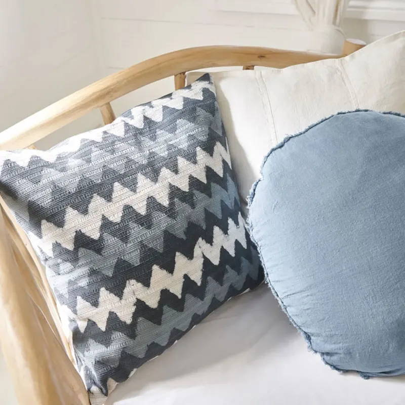 Blue linen cushions styled on a cane chair