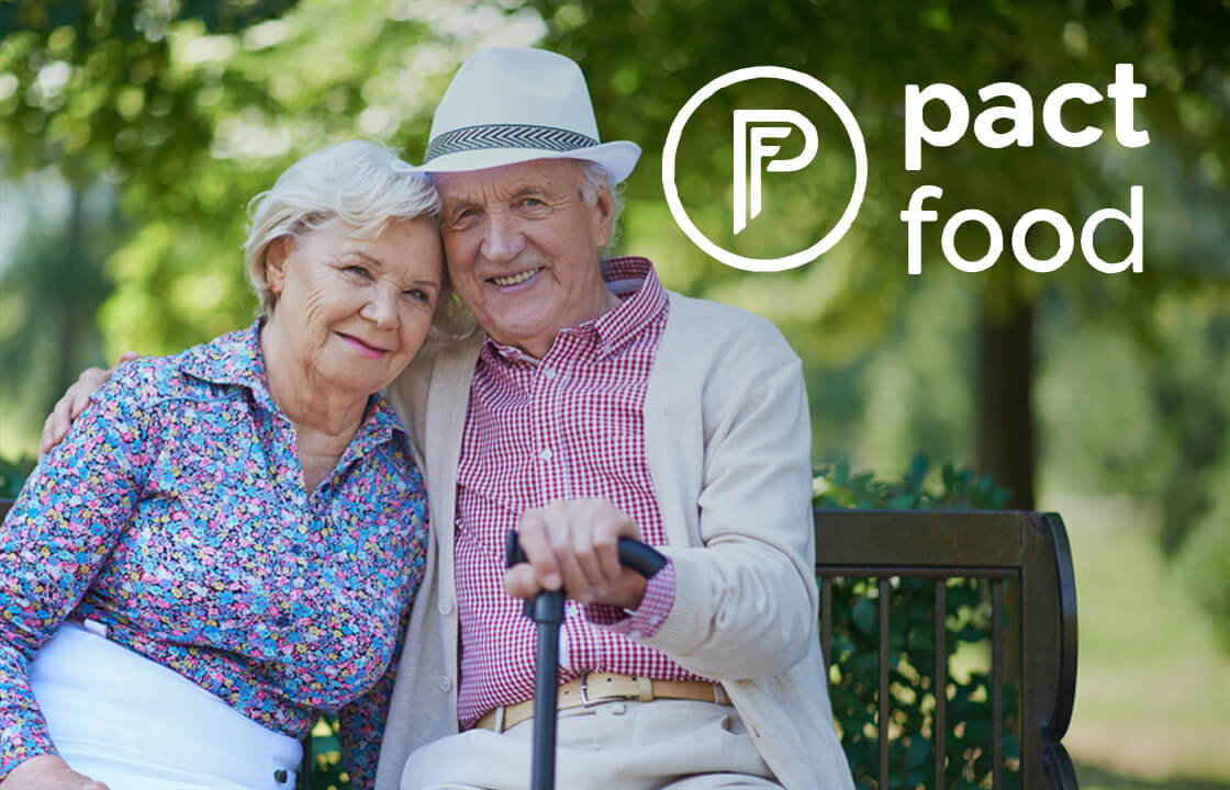 Image Of Older Woman & Man With Pact Food Logo In the Right Hand Top Corner