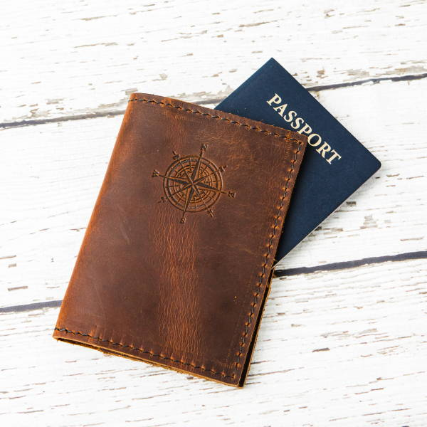 Leather passport cover with compass stamp