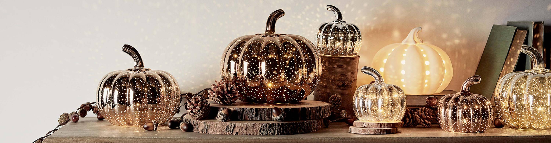 Assortment of illuminated pumpkin lights on table