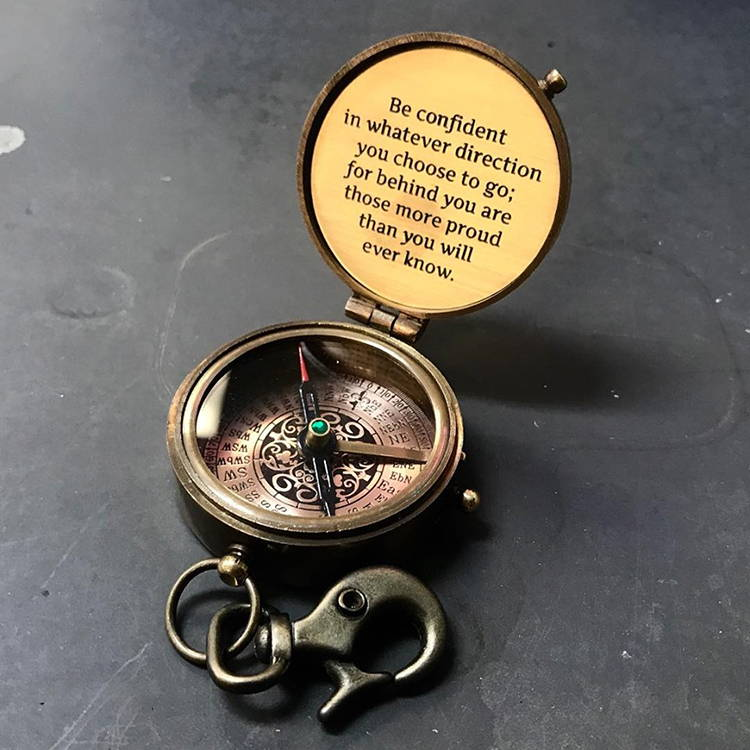 A compass engraved with a quote.