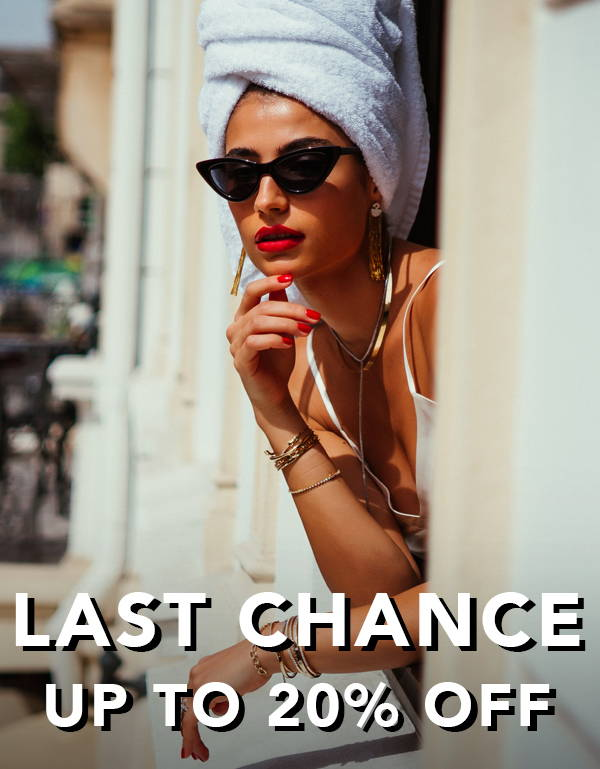 Model learning out balcony window wearing Ring Concierge jewelry LAST CHANCE up to 20% off