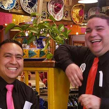 Customer spotlight at a mexican resturant waiters wearing colorful ties