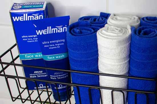 wellman grooming products in basket with towels