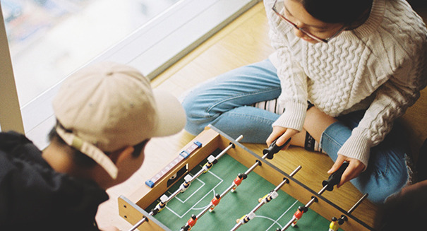 a couple playing foosball together