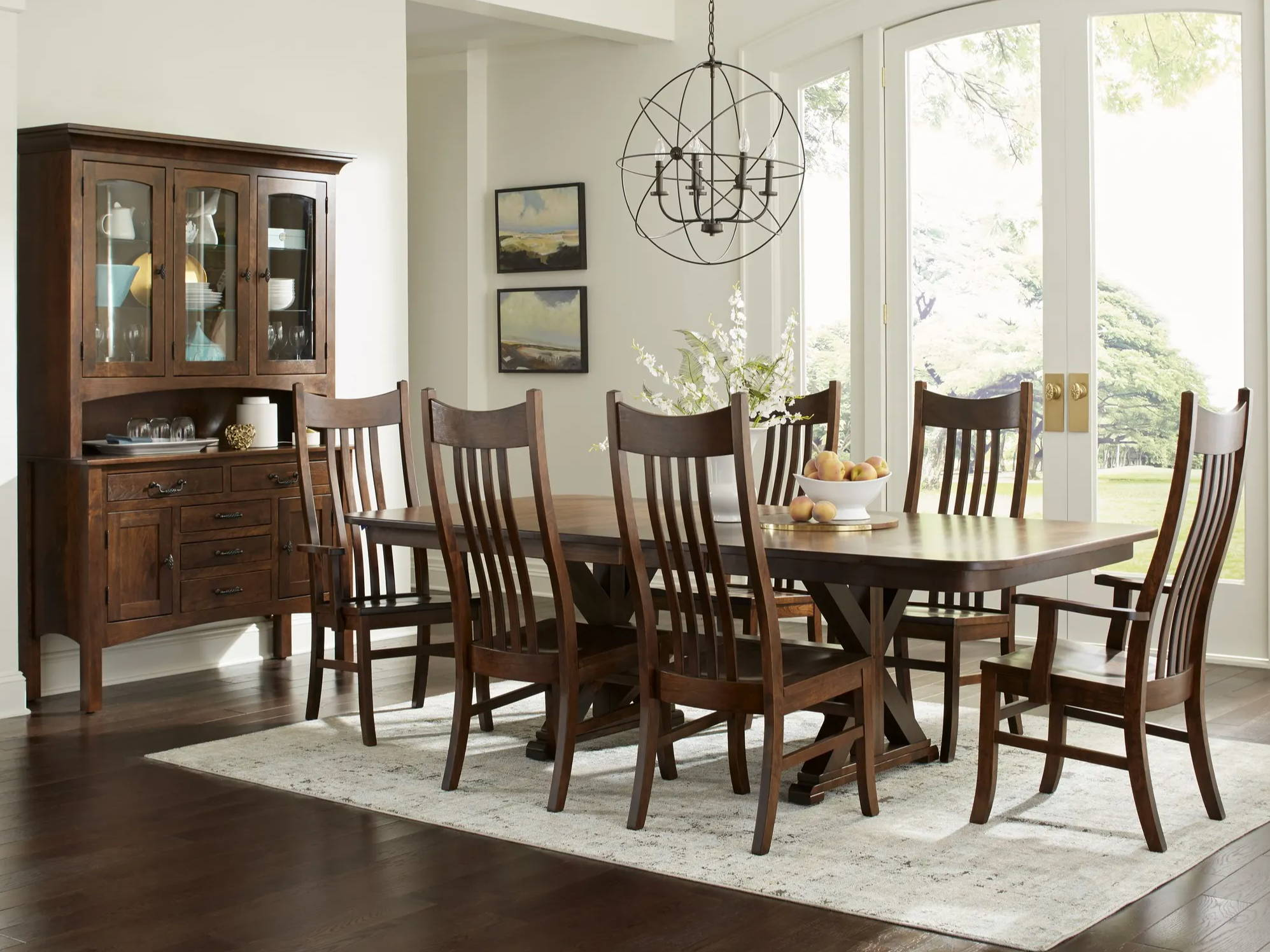 dining room scene with dark brown wood table and chairs with a china cabinet on left hand wall